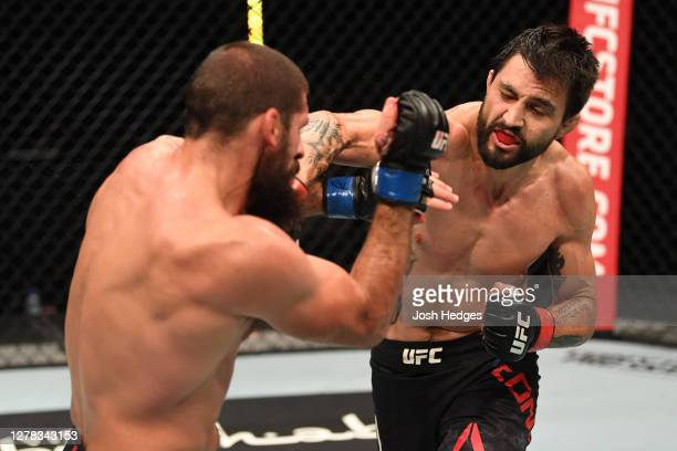 Carlos Condit punches Court McGee in their welterweight bout during the UFC Fight Night event inside Flash Forum on UFC Fight Island on October 04,...