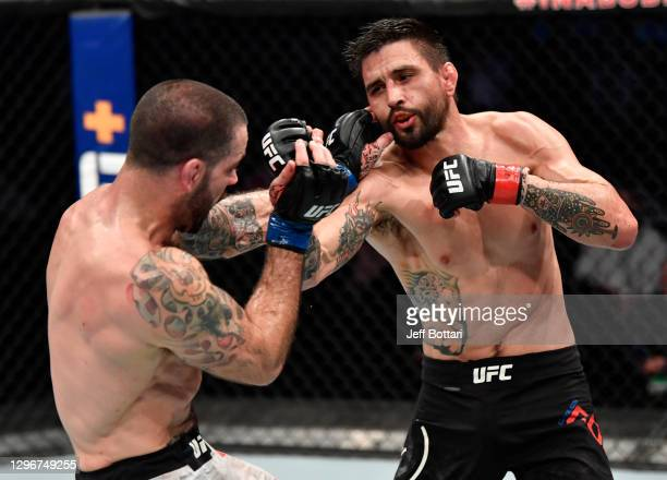 Carlos Condit punches Matt Brown in a welterweight bout during the UFC Fight Night event at Etihad Arena on UFC Fight Island on January 17, 2021 in...