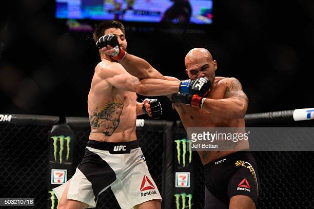 Carlos Condit punches Robbie Lawler in their UFC welterweight championship bout during the UFC 195 event inside MGM Grand Garden Arena on January 2...