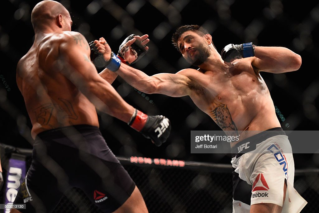 Carlos Condit punches Robbie Lawler in their UFC welterweight championship bout during the UFC 195 event inside MGM Grand Garden Arena on January 2, 2016 in Las Vegas, Nevada.