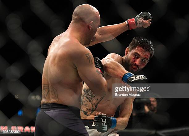 Carlos Condit punches Robbie Lawler in their welterweight championship fight during the UFC 195 event inside MGM Grand Garden Arena on January 2,...