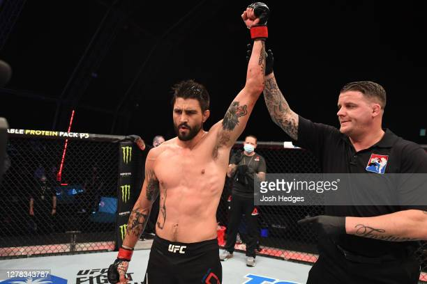 Carlos Condit reacts after defeating Court McGee in their welterweight bout during the UFC Fight Night event inside Flash Forum on UFC Fight Island...