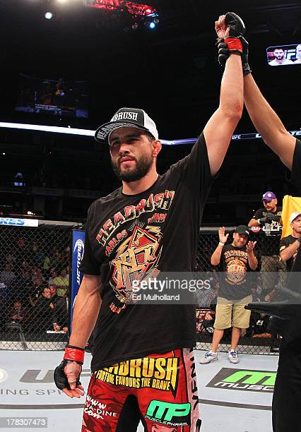 Carlos Condit reacts after his TKO victory over Martin Kampmann in their welterweight fight during the UFC on FOX Sports 1 event at Bankers Life...