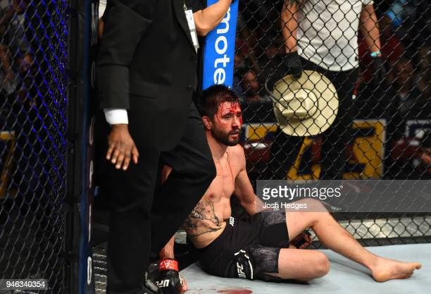 Carlos Condit reacts to his submission loss to Alex Oliveira of Brazil in their welterweight fight during the UFC Fight Night event at the Gila...