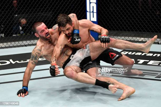 Carlos Condit takes down Matt Brown in a welterweight bout during the UFC Fight Night event at Etihad Arena on UFC Fight Island on January 17, 2021...