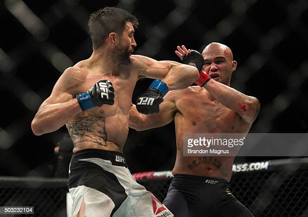 Carlos Condit throws a spinning back elbow at Robbie Lawler in their welterweight championship fight during the UFC 195 event inside MGM Grand Garden...