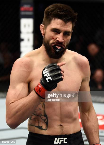 Carlos Condit walks back to his corner after the first round of his welterweight bout against Neil Magny during the UFC 219 event inside TMobile...