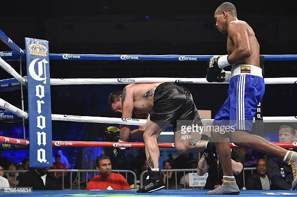 Carlos Congora of Ecuador chases Zacharia Kelley of the US to the ropes before Congora won with a technical knock out in their light heavyweight...