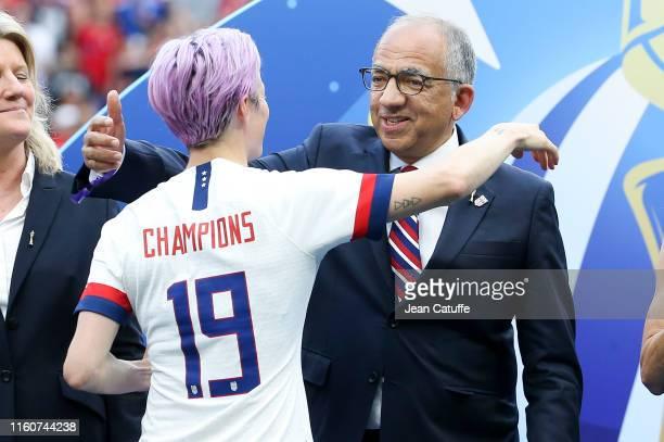 Carlos Cordeiro President US Soccer Federation congratulates Megan Rapinoe of USA during the trophy ceremony following the 2019 FIFA Women's World...