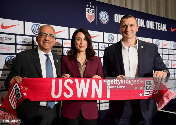 Carlos Cordeiro US Soccer President and Kate Markgraf US Women's National Team General Manager pose for a photo with Vlatko Andonovski at a press...