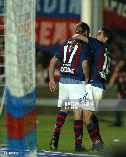 Carlos Cordone and Leandro Romagnoli of San Lorenzo of Argentina celebrate the 4th goal of their team against Bolivar of Bolivia during the...
