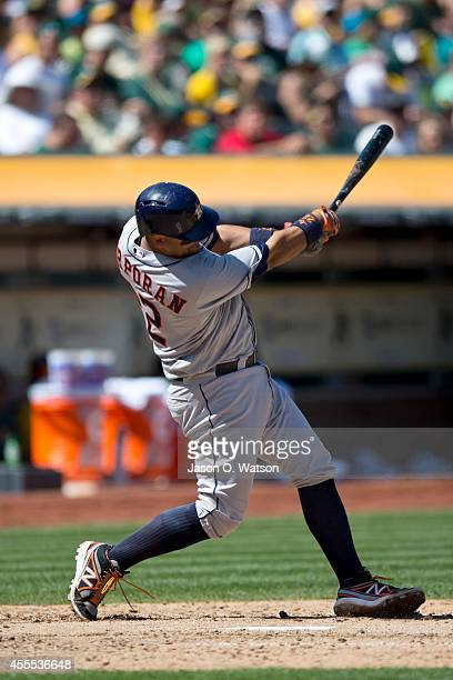 Carlos Corporan of the Houston Astros at bat against the Oakland Athletics during the sixth inning at Oco Coliseum on September 6 2014 in Oakland...