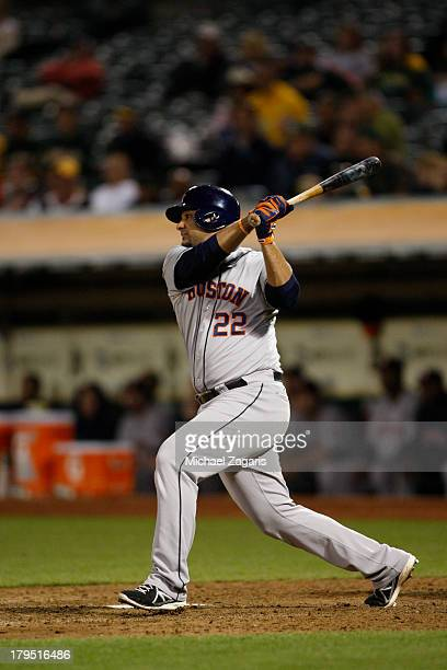 Carlos Corporan of the Houston Astros bats during the game against the Oakland Athletics at Oco Coliseum on August 14 2013 in Oakland California The...
