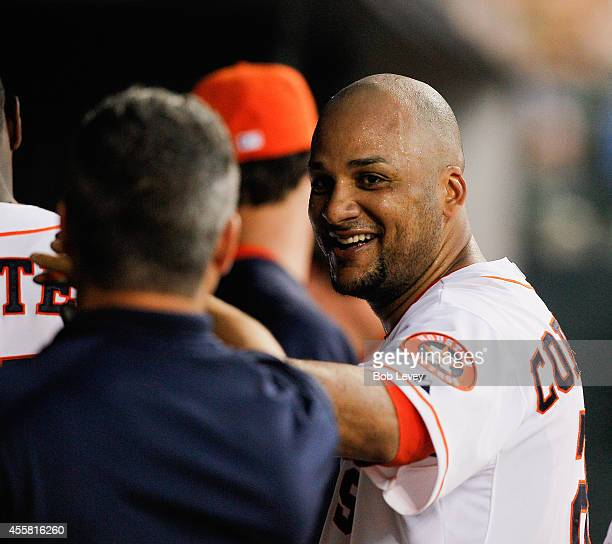 Carlos Corporan of the Houston Astros celebrates in the dugout after hiting a home run in the fourth inning against the Seattle Mariners at Minute...