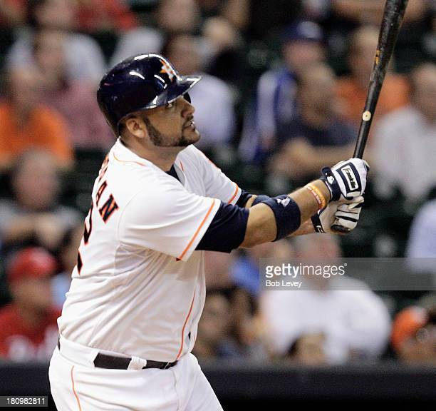 Carlos Corporan of the Houston Astros doubles in the sixth inning against the Cincinnati Reds at Minute Maid Park on September 18 2013 in Houston...