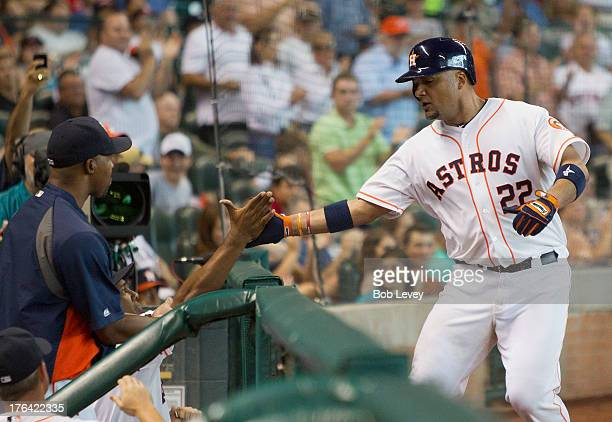 Carlos Corporan of the Houston Astros greeted by managher Bo Porter of the Houston Astros after hitting a home run in the ninth inning to break up a...
