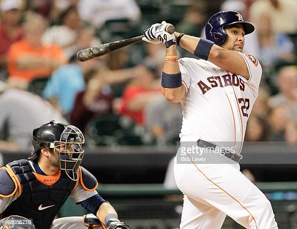Carlos Corporan of the Houston Astros hits a home run to right field in the seventh inning against the Detroit Tigers at Minute Maid Park on May 4...