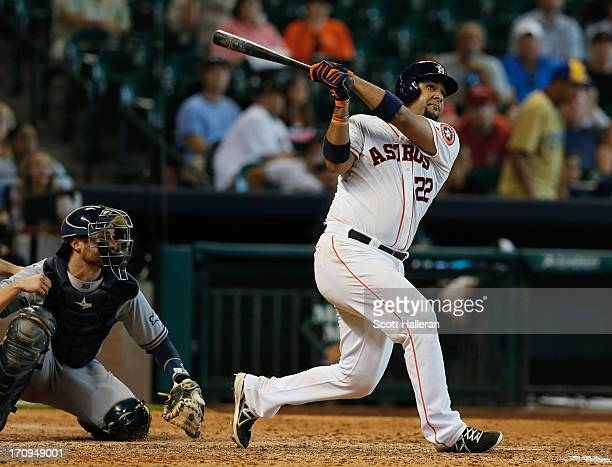 Carlos Corporan of the Houston Astros hits a solo home run to left field in the eighth inning during the game against the Milwaukee Brewers at Minute...