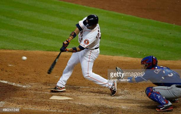 Carlos Corporan of the Houston Astros hits a threerun home run in the fifth inning of their game against the Texas Rangers at Minute Maid Park on May...