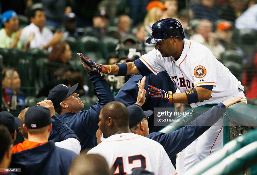 Carlos Corporan of the Houston Astros is greeted by his teammates after hitting a home run in the fifth inning against the Kansas City Royals at Minute Maid Park on April 15, 2014 in Houston, Texas. All uniformed team members are wearing jersey number 42 in honor of Jackie Robinson Day.