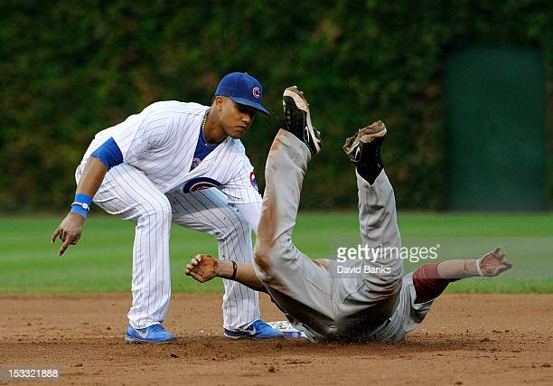 Carlos Corporan of the Houston Astros is tagged out by Starlin Castro of the Chicago Cubs on a steal attempt in the eighth inning on October 3 2012...