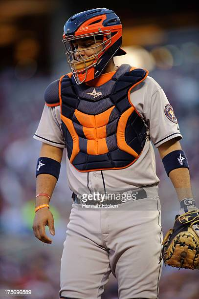 Carlos Corporan of the Houston Astros looks on while catching during the game against the Minnesota Twins on August 2 2013 at Target Field in...