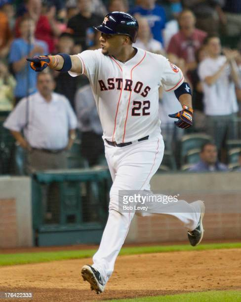 Carlos Corporan of the Houston Astros points to the bench as he crosses home plate after hitting a home run in the ninth inning to break up a no...
