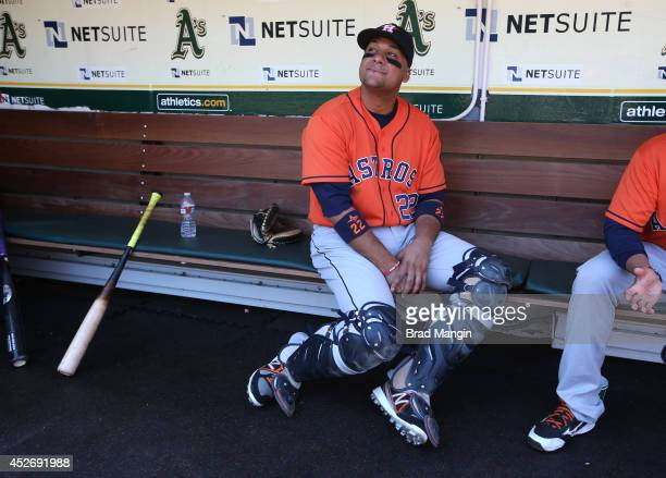 Carlos Corporan of the Houston Astros sits in the dugout before the game against the Oakland Athletics at Oco Coliseum on Thursday July 24 2014 in...