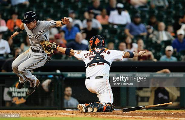 Carlos Corporan of the Houston Astros tags Scooter Gennett of the Milwaukee Brewers out at home plate in the ninth inning during the game against the...