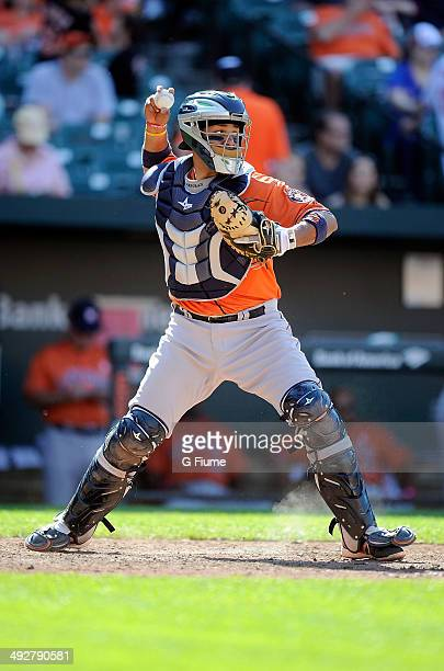 Carlos Corporan of the Houston Astros throws the ball to second base against the Baltimore Orioles at Oriole Park at Camden Yards on May 11 2014 in...