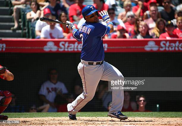 Carlos Corporan of the Texas Rangers bats in the third inning against the Los Angeles Angels of Anaheim during the MLB game at Angel Stadium of...