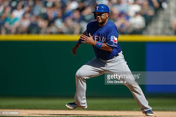 Carlos Corporan of the Texas Rangers leads off of first base against the Seattle Mariners at Safeco Field on April 19 2015 in Seattle Washington