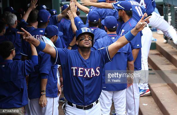 Carlos Corporan of the Texas Rangers watches the instant replay after scoring in the seventh inning against the Houston Astros at Globe Life Park in...