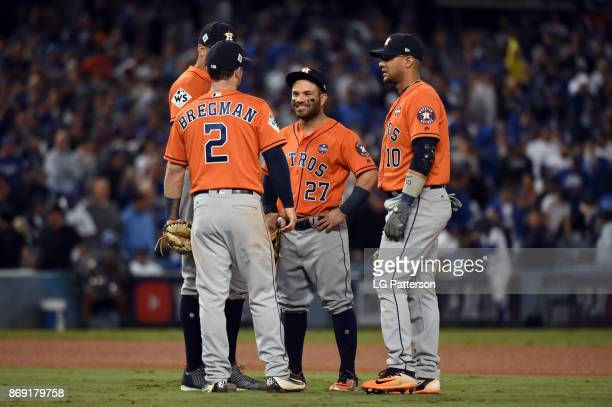 Carlos Correa Alex Bregman Jose Altuve and Yuli Gurriel of the Houston Astros meet in the infield during a pitching change during Game 7 of the 2017...