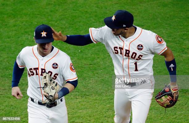 Carlos Correa and Alex Bregman of the Houston Astros celebrate during the sixth inning against the Los Angeles Dodgers in game four of the 2017 World...