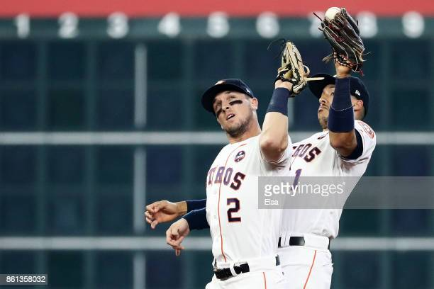 Carlos Correa and Alex Bregman of the Houston Astros collide catching a pop fly by Greg Bird of the New York Yankees in the second inning during game...