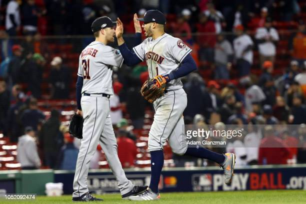 Carlos Correa and Collin McHugh of the Houston Astros celebrate after the Astros defeated the Boston Red Sox in Game 1 of the ALCS at Fenway Park on...
