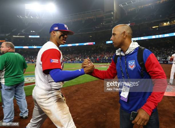 Carlos Correa and General Manager Alex Cora of Team Puerto Rico celebrates after Game 4 of Pool F of the 2017 World Baseball Classic on Friday March...