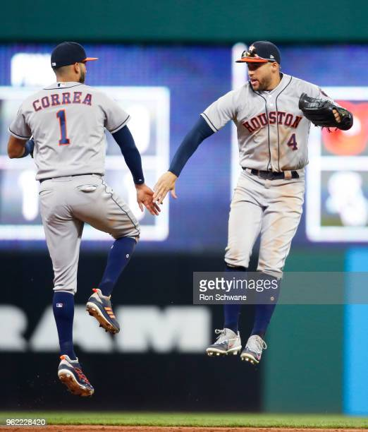 Carlos Correa and George Springer of the Houston Astros celebrate an 82 victory over the Cleveland Indians at Progressive Field on May 24 2018 in...