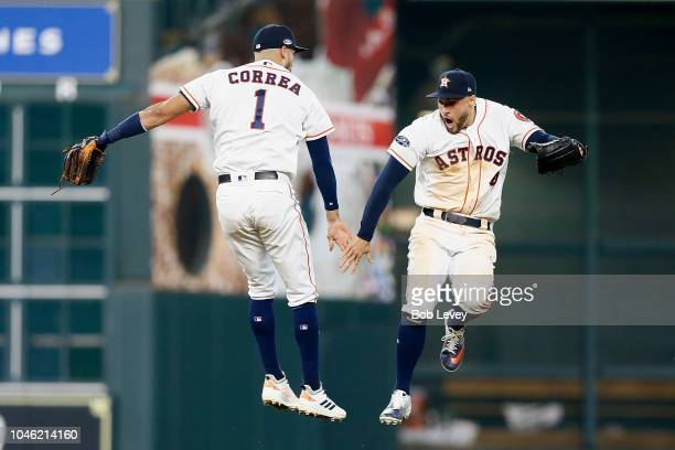 Carlos Correa and George Springer of the Houston Astros celebrate after defeating the Cleveland Indians 72 in Game One of the American League...