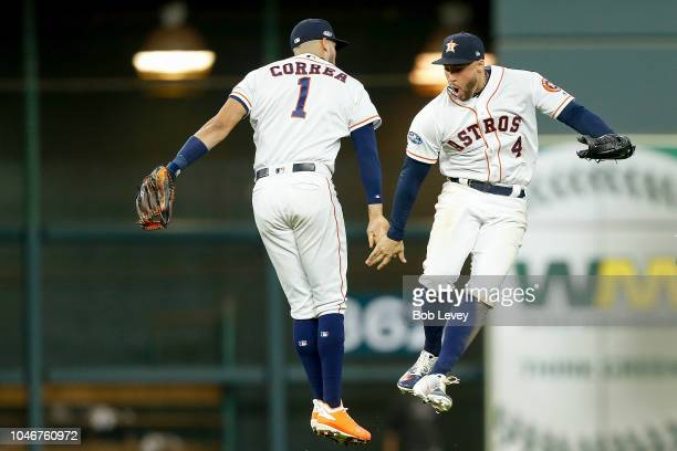 Carlos Correa and George Springer of the Houston Astros celebrate after defeating the Cleveland Indians 31 in Game Two of the American League...