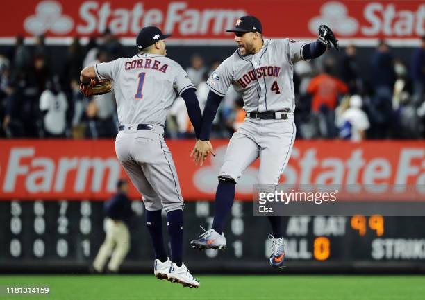 Carlos Correa and George Springer of the Houston Astros celebrate defeating the New York Yankees 41 in game three of the American League Championship...
