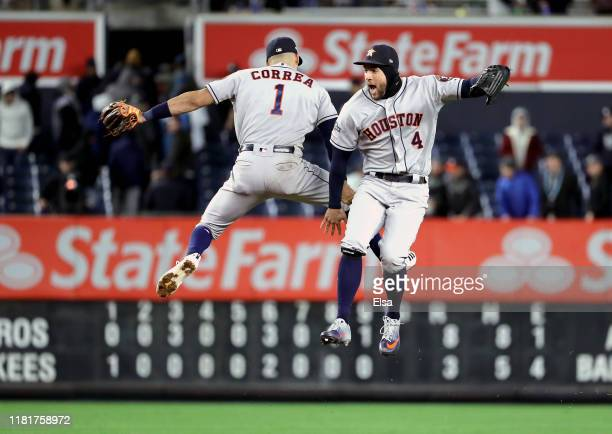 Carlos Correa and George Springer of the Houston Astros celebrate their teams 83 win over the New York Yankees in game four of the American League...