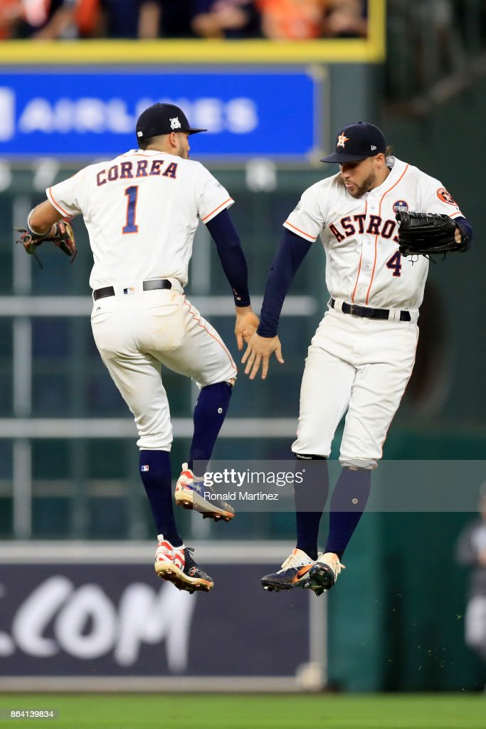 Carlos Correa #1 and George Springer #4 of the Houston Astros celebrate after defeating the New York Yankees with a score of 7 to 1 in Game Six of the American League Championship Series at Minute Maid Park on October 20, 2017 in Houston, Texas.