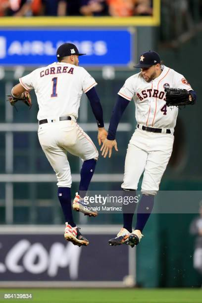 Carlos Correa and George Springer of the Houston Astros celebrate after defeating the New York Yankees with a score of 7 to 1 in Game Six of the...