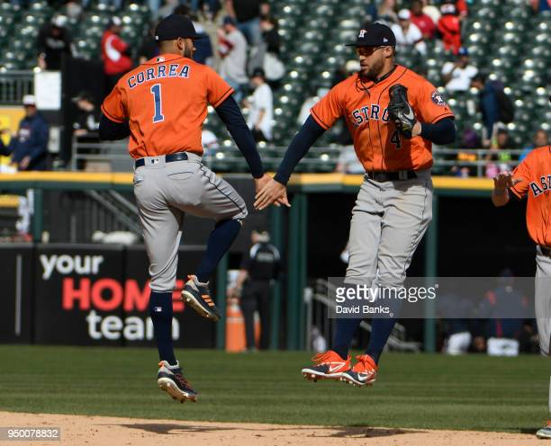 Carlos Correa and George Springer of the Houston Astros celebrate their win against the Chicago White Sox on April 22 2018 at Guaranteed Rate Field...