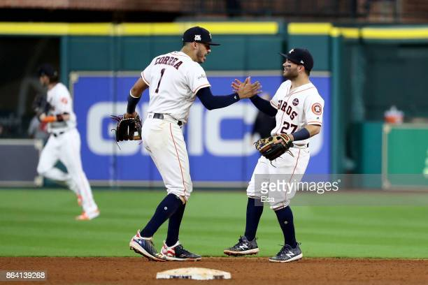 Carlos Correa and Jose Altuve of the Houston Astros celebrate after defeating the New York Yankees with a score of 7 to 1 in Game Six of the American...