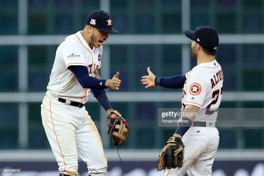 Carlos Correa #1 and Jose Altuve #27 of the Houston Astros celebrate after defeating the New York Yankees with a score of 7 to 1 in Game Six of the American League Championship Series at Minute Maid Park on October 20, 2017 in Houston, Texas.