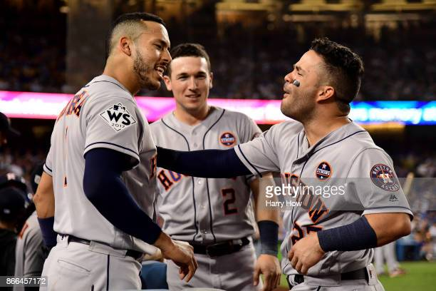 Carlos Correa and Jose Altuve of the Houston Astros celebrate after hitting solo home runs during the tenth inning against the Los Angeles Dodgers in...