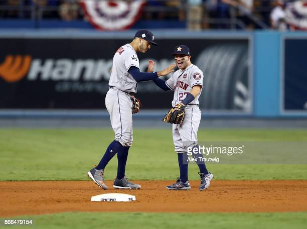 Carlos Correa and Jose Altuve of the Houston Astros celebrate after winning Game 2 of the 2017 World Series against the Los Angeles Dodgers at Dodger...